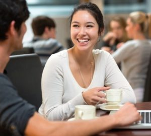 Students chatting in college cafe